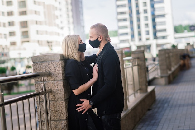 Couple wearing fashionable protective masks