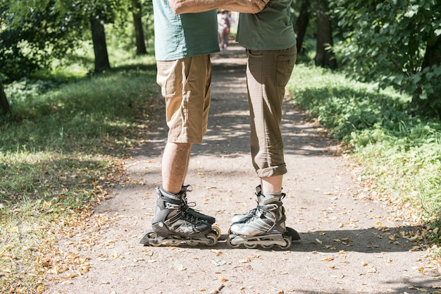 Couple wearing roller skates hugging