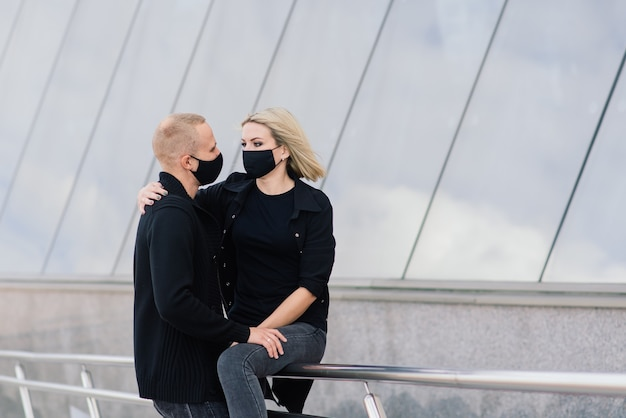 Couple wearing trendy fashionable protective masks