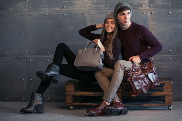 Couple in winter cloths in studio