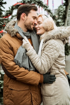 Couple in winter hugging and being happy