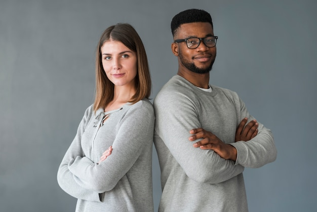 Couple with arms crossed