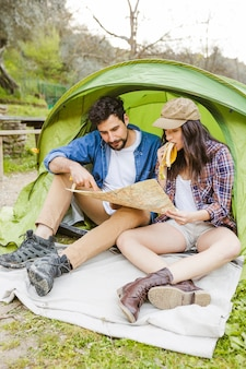 Couple with bananas reading map