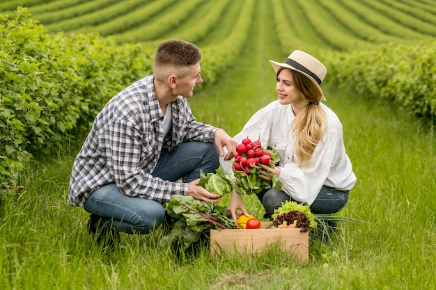 Couple with basket of vegetables