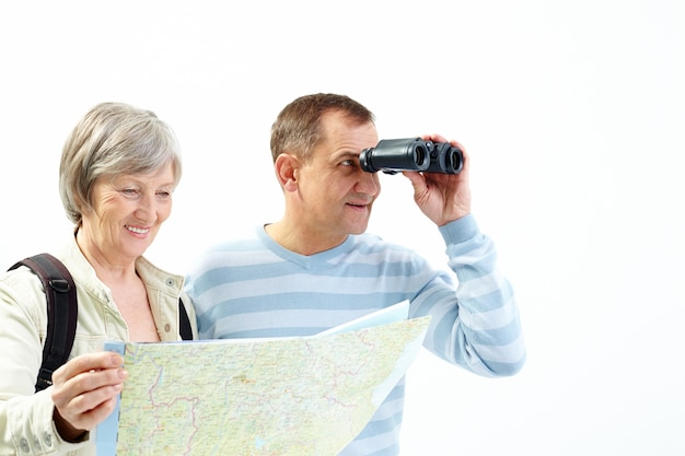 Couple with binoculars and map