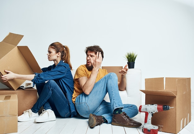 Couple with boxes moving