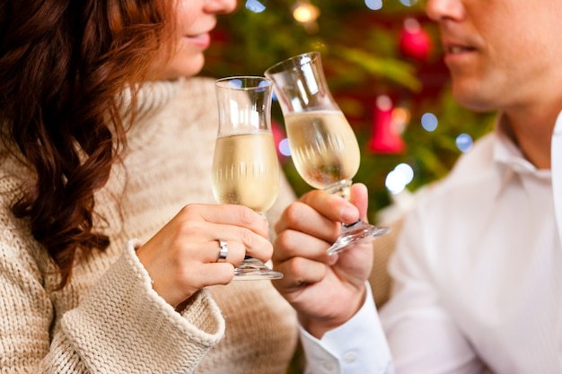 Couple with champagne on christmas eve
