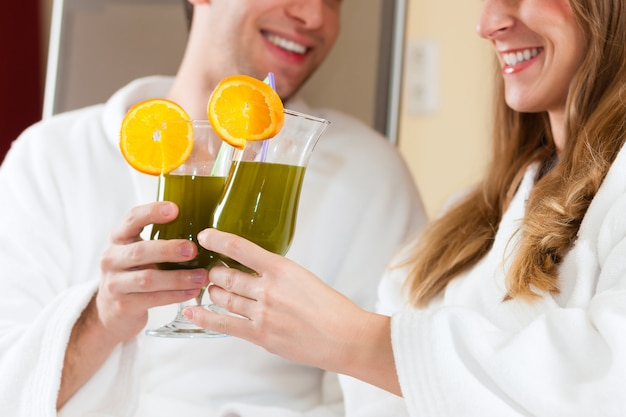 Couple with chlorophyll-shake in spa