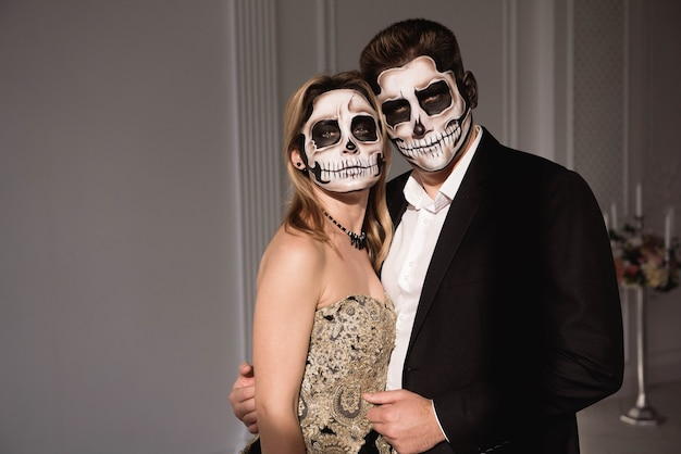 Couple with dark skull makeup on white space