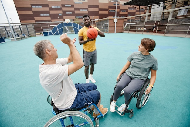 Couple with disability learning to play basketball