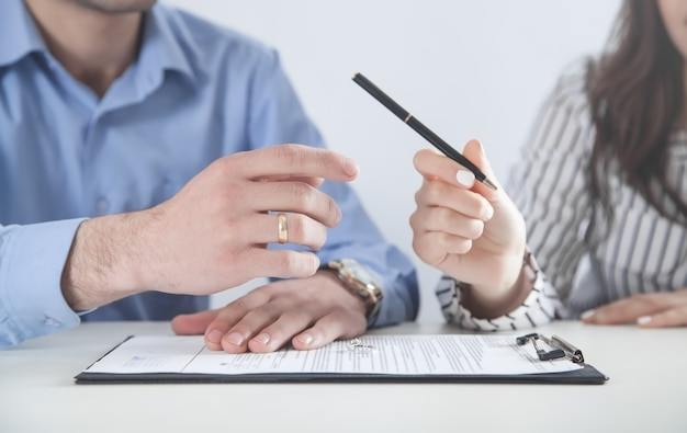 Couple with divorce contract and ring