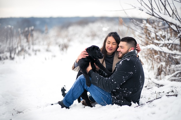 Couple with dog in winter