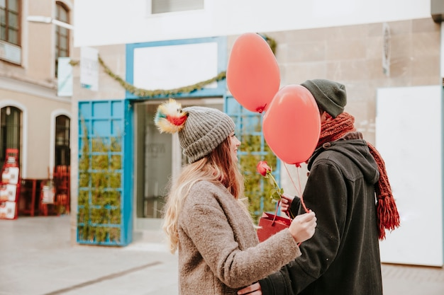 Couple with gifts on street