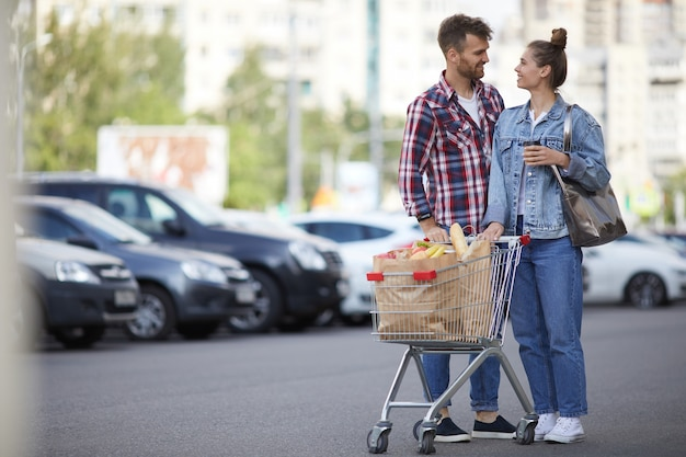 Couple with groceries in parking lot