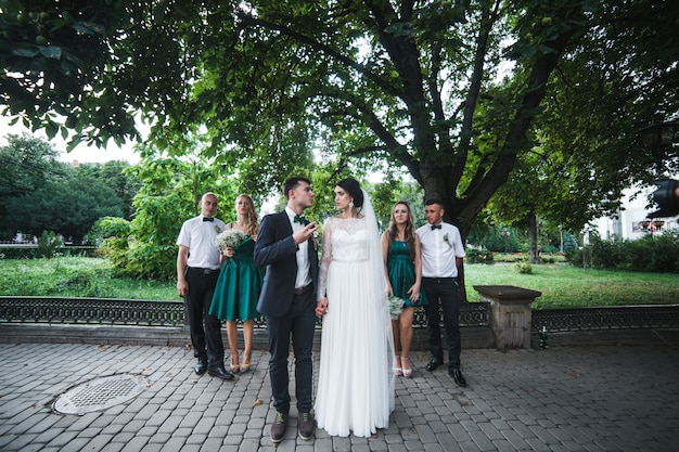 Couple with guests posing on street