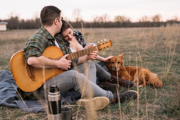 Couple with guitar and dog