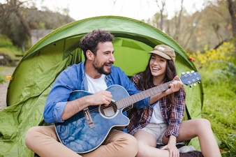 Couple with guitar singing songs