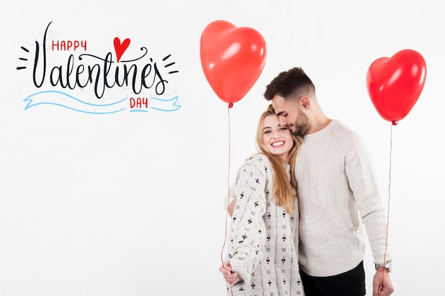 Couple with heart  ballons on valentines day
