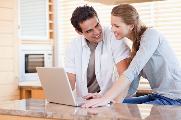 Couple with laptop in the kitchen
