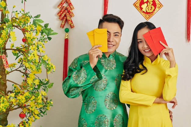 Couple with lucky money envelopes