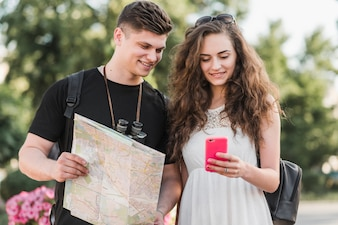 Couple with map using smartphone