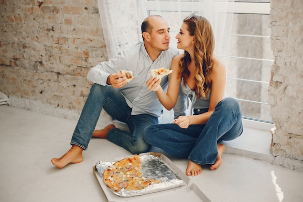 Couple with pizza