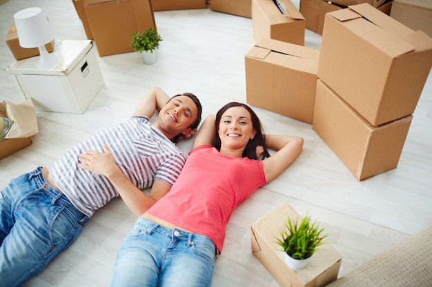 Couple with the room full of boxes