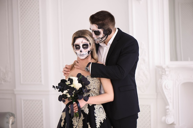 Couple with skull make up for halloween