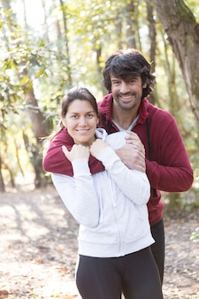 Couple with sportswear hugging in the park