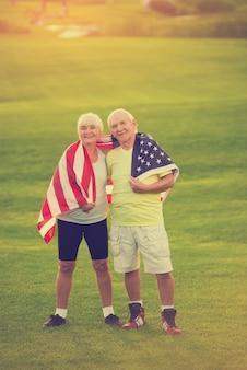 Couple with usa flag smiling