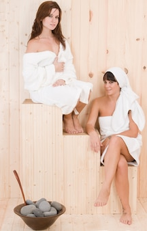 Couple of women enjoying together in a spa s