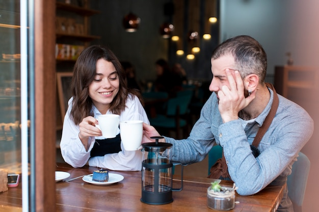 Couple working at coffee shop and drinking coffee