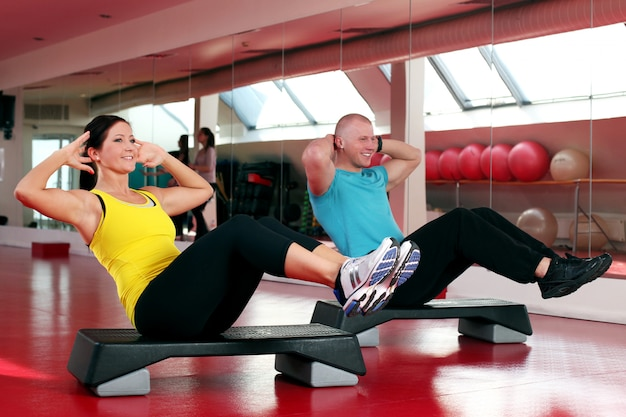 Couple working out in a fitness gym