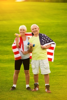 Couple wrapped in american flag