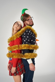 Couple wrapped in golden christmas chain