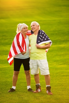 Couple wrapped in usa flag