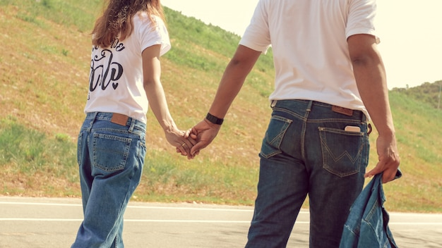 Couples walk and hold hands while traveling