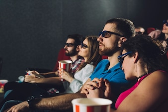 Couples watching film in cinema