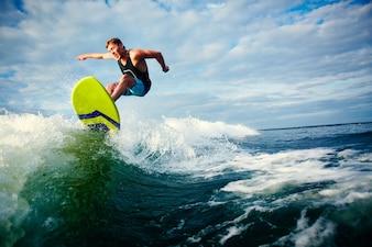 Courageous surfer riding a wave
