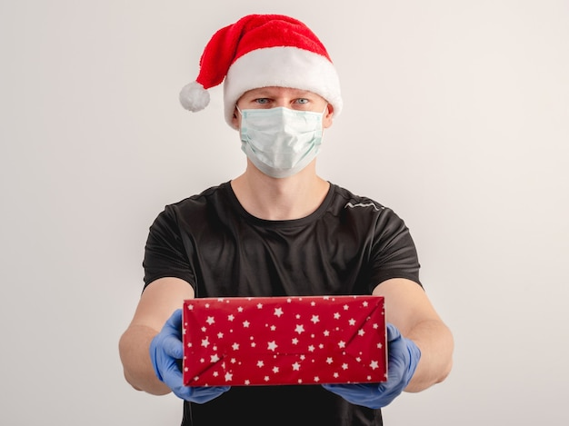 A courier delivers a parcel on christmas day during the coronavirus pandemic