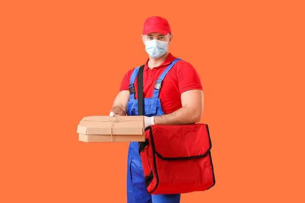 Courier of food delivery service on red