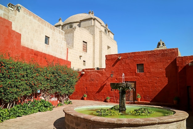Courtyard of the convent of santa catalina de siena with vintage stone fountain arequipa city peru