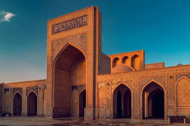 Courtyard of kalyan mosque at sunset, bukhara, uzbekistan. world heritage