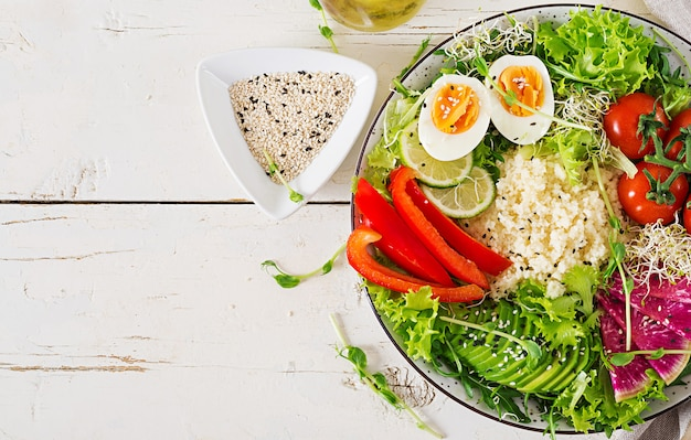 Couscous, egg and vegetables bowl.