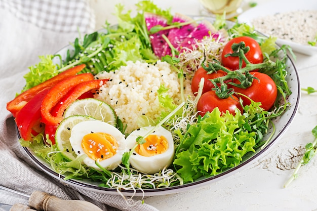 Couscous, egg and vegetables bowl