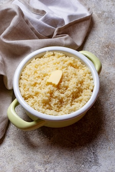 Couscous with butter in pot