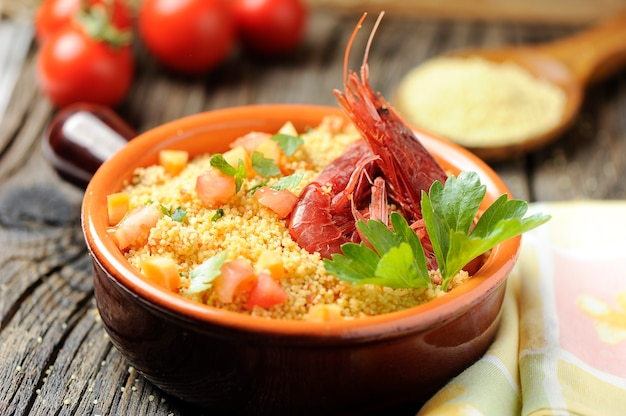 Couscous with seafood in a bowl