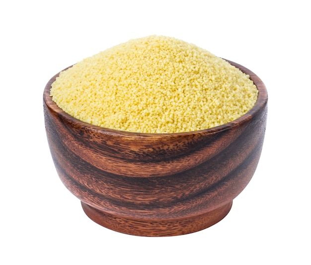 Couscous in wooden bowl isolated on white