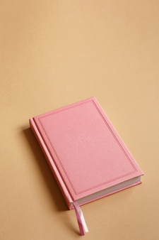 Cover of pink notebook, diary or book on brown paper