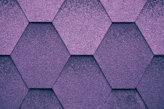 Cover at shape of rhombus. dark purple roof tile background.